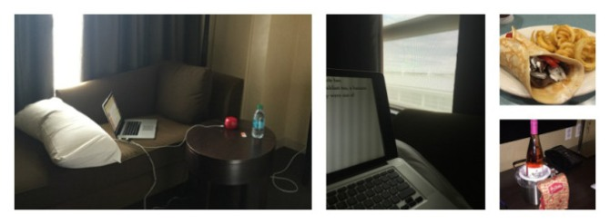 "My writer's perch (a long couch in the hotel room, my ""view"" of the parking garage, an original Olga with fries and wine with cookies."